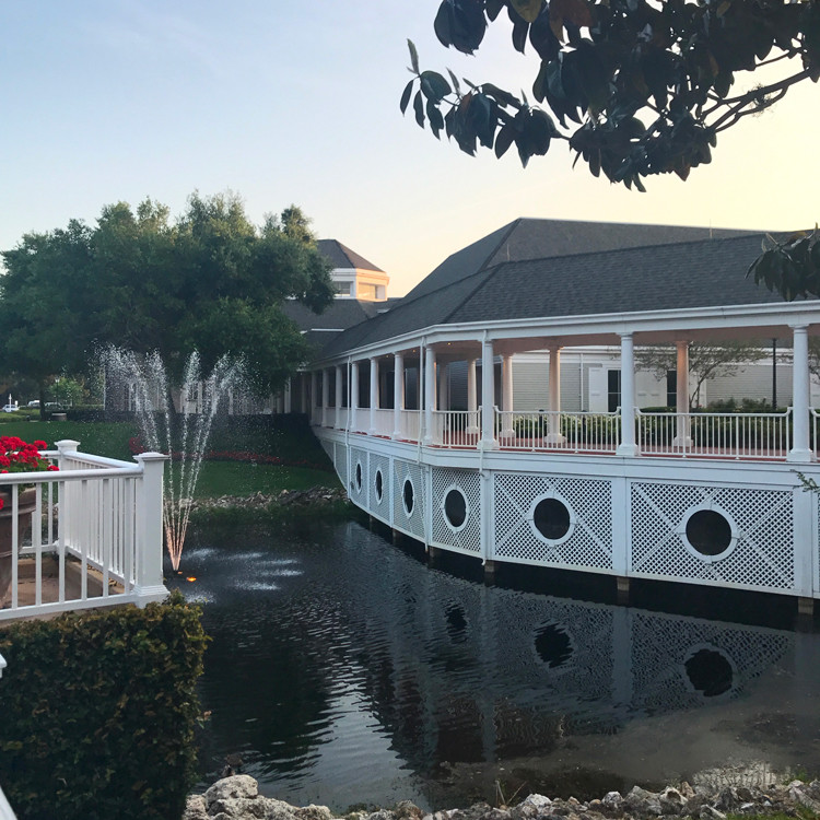a walkway, gazebo, fountain, and lake at Disney's Yacht Club and Beach Club Resorts
