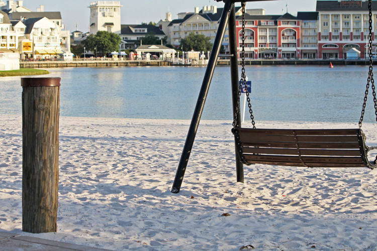 beach at Walt Disney World's Beach Club and Yacht Club resorts, with a swing, and Disney's Boardwalk in the background