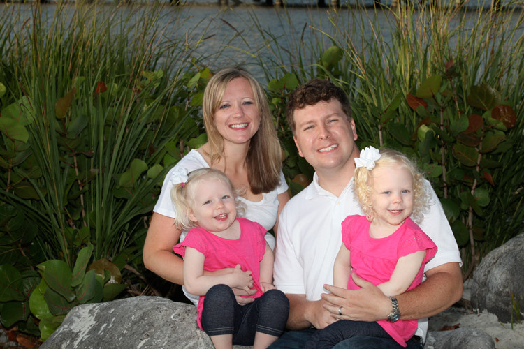 A family portrait with a lush lake background, taken at Disney's Beach Club resort