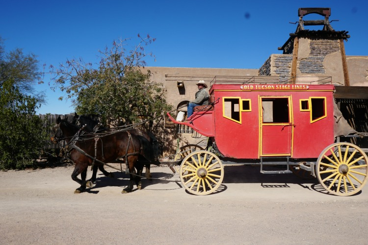 Riding the western stagecoach at Old Tucson Studios is also another way to experience family fun in Tucson. Photo by Multidimensional TravelingMom, Kristi Mehes.