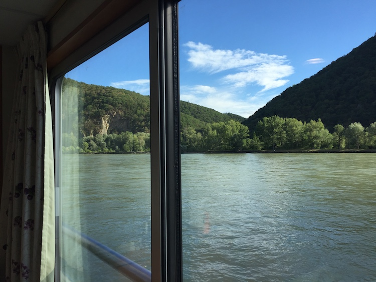 On a European river cruise, the view of the riverbank