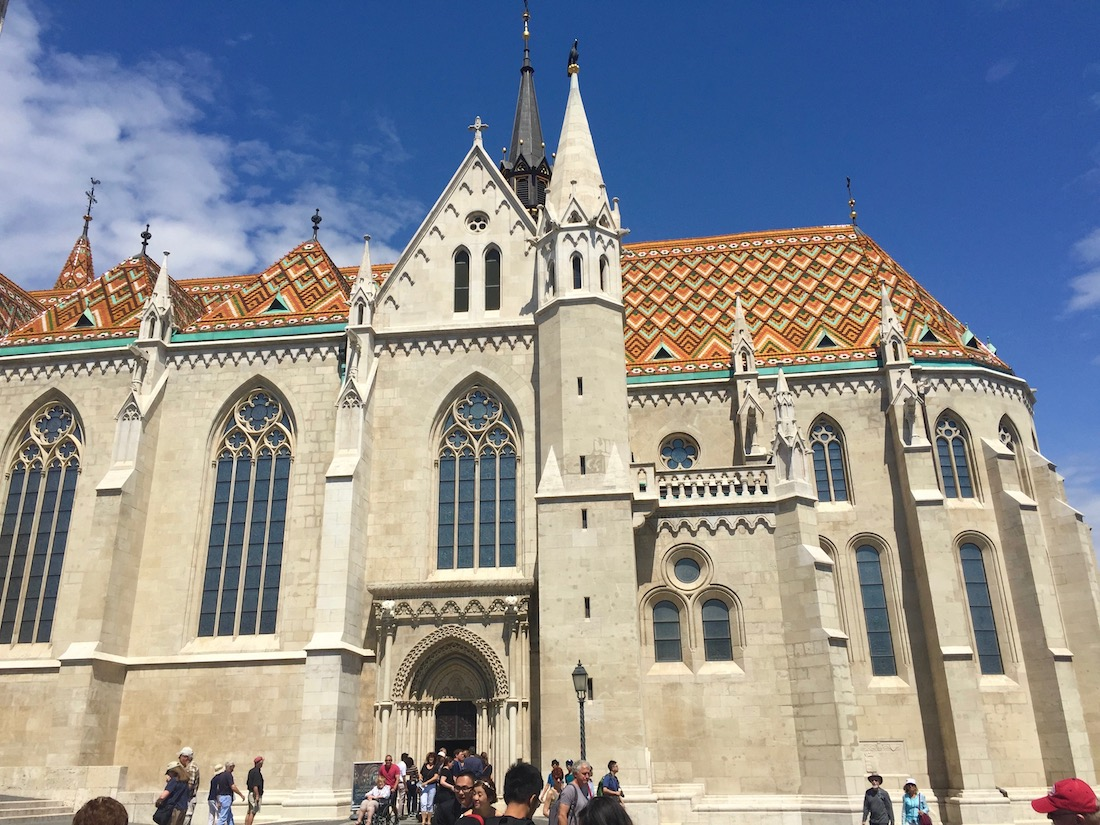 Viewing Matthias Church's brightly tiled roof against a blue sky, one of many things to do in Budapest., Hungary.