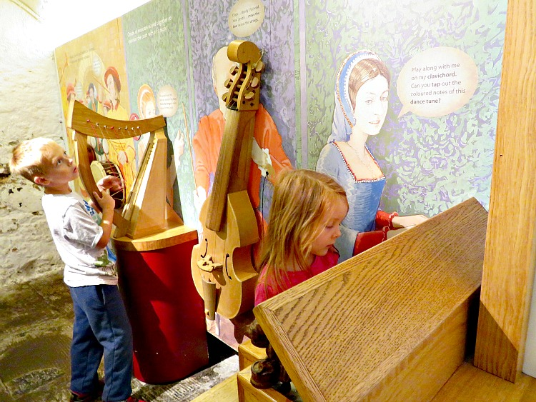 When visiting castles with kids, it's fun for them to get hands on like with these instruments.