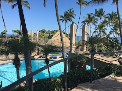 Pool and rope bridge fun when checking in for family fun on your Hawaiian vacation at the Hilton Waikoloa Village