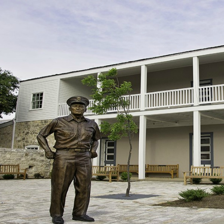 A statue of Admiral Nimitz in Fredricksburg, Texas with kids