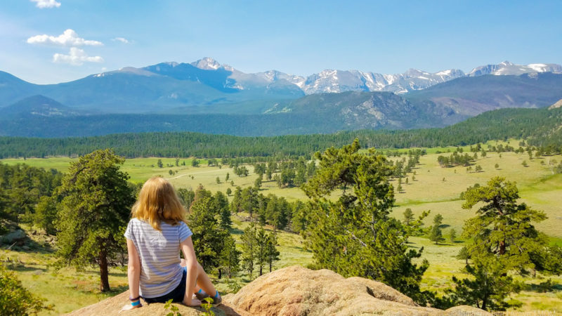 kid overlooking the Rocky Mountains near Estes Park, CO