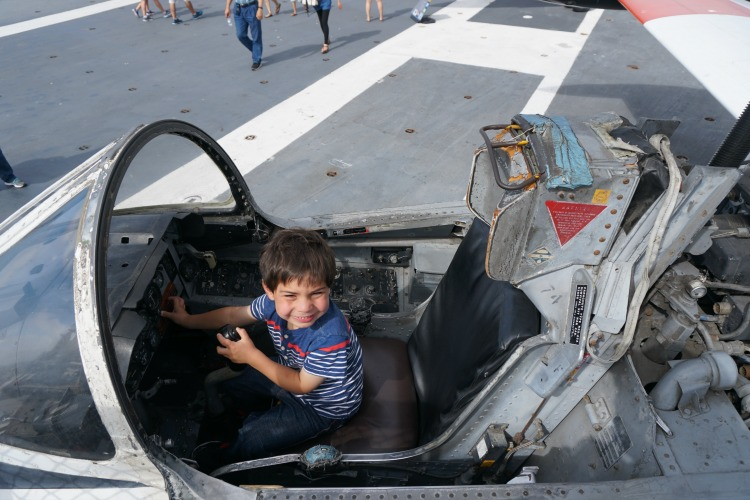 My son loves seeing the different planes at the U.S.S. Midway. Photo by Multidimensional TravelingMom, Kristi Mehes.