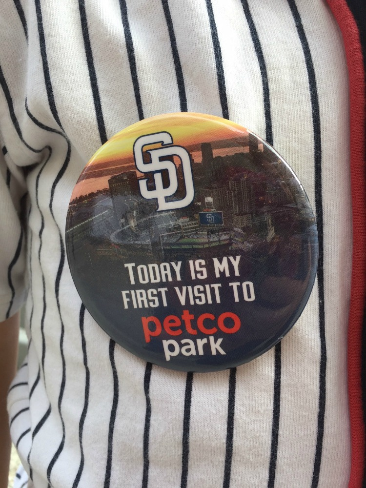 First time visitors to Petco Park receive a commemorative pin, and a fun souvenir to bring back home. Photo by Multidimensional TravelingMom, Kristi Mehes.