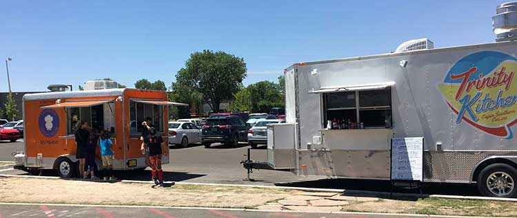 Food trucks outside of Meow Wolf allow families to taste local cuisine at family friendly restaurants in Santa Fe, New Mexico.