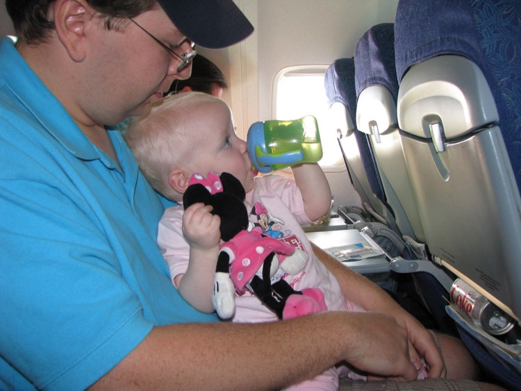 During take-off, give toddler drinks watert to keep kids happy when traveling.