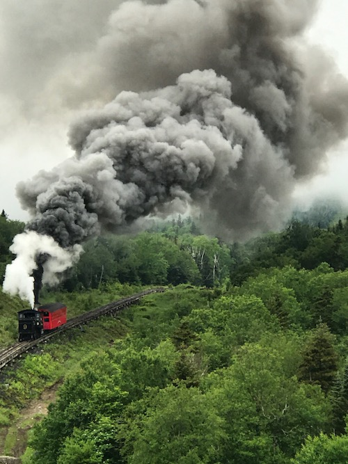 Ride a classic steam engine at the Mount Washington Cog Railway, a New Hampshire road trip attraction.