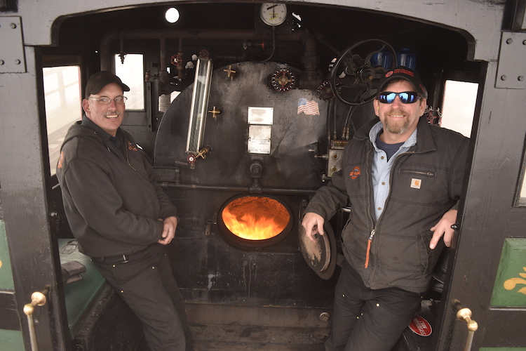 Steam engineers on the Mount Washington Cog Railway, friendly guides during a New Hampshire road trip.