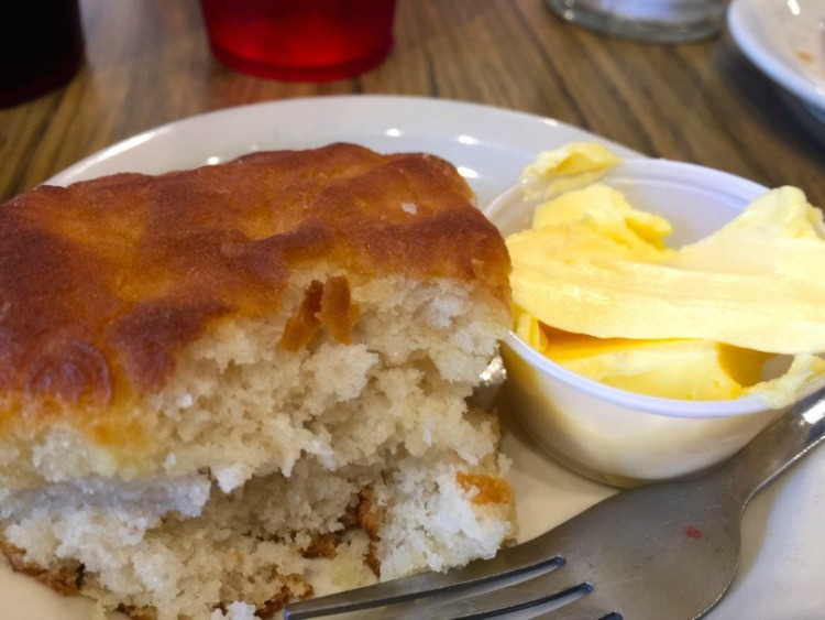 The buttered biscuits from Strawn's Eat Shop are phenomenal and a perfect food in Shreveport to not miss.