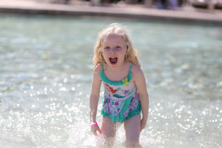 Preschooler excited at Disney's Stormalong Bay, a favorite Disney pool for kids