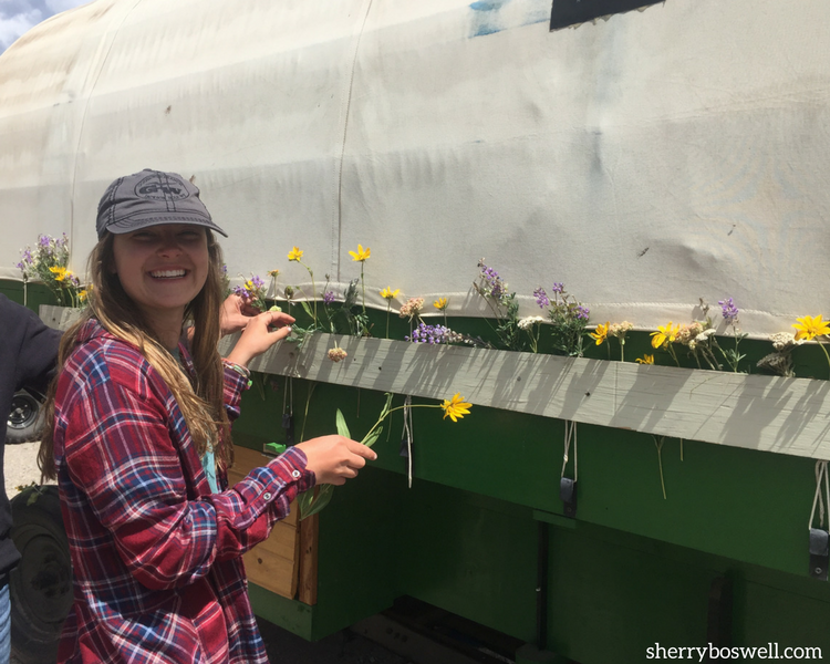 Glamping at Goosewing Ranch included fun decorating a covered wagon with flowers.