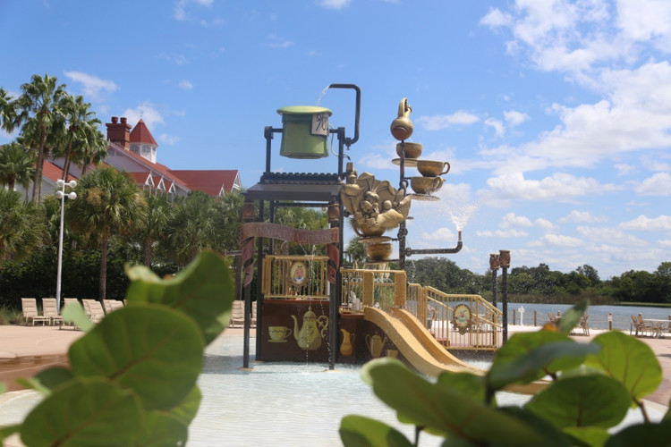 "An ""Alice in Wonderland"" themed play area (perfect for kids) at Disney's Grand Floridian Resort includes small water slides and interactive water features"