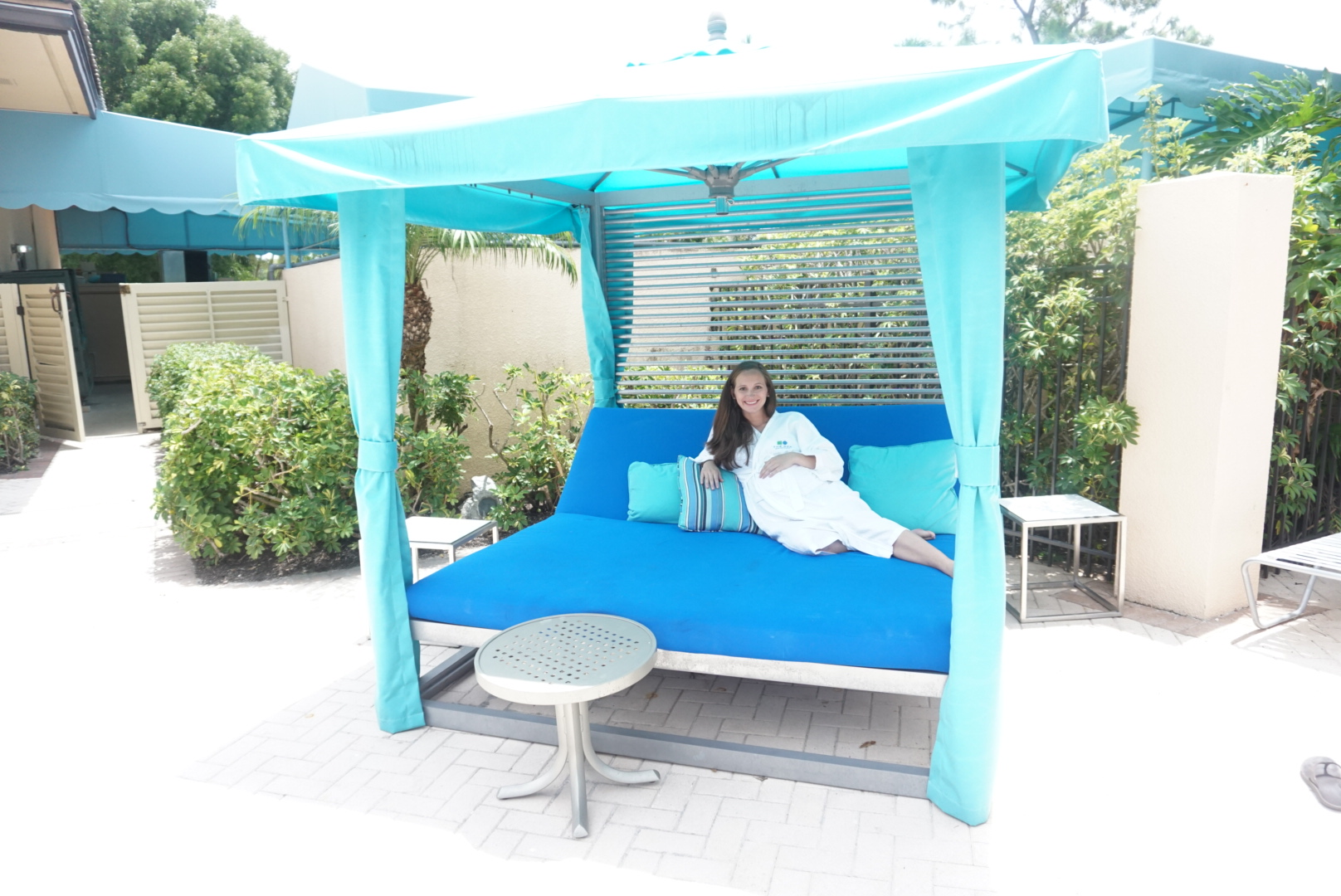 Relaxing by the spa pool is a major bonus for moms vacationing in The Palm Beaches.