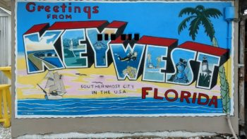 A colorful sign greets visitors and teens to Key West.