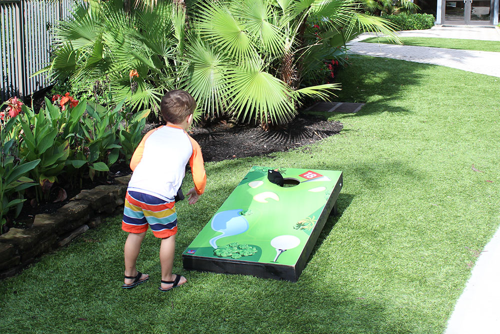 There are several outdoor games set up by the pool for kids to play at PGA National Resort and Spa.