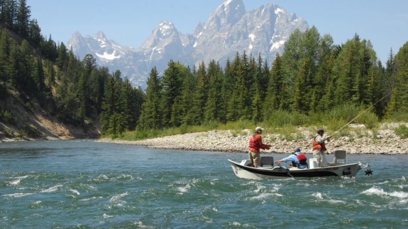 A dude ranch family vacation can include numerous outdoor activities like fishing. Triangle X Ranch is a dude ranch vacation destination in Jackson Hole, Wyoming.