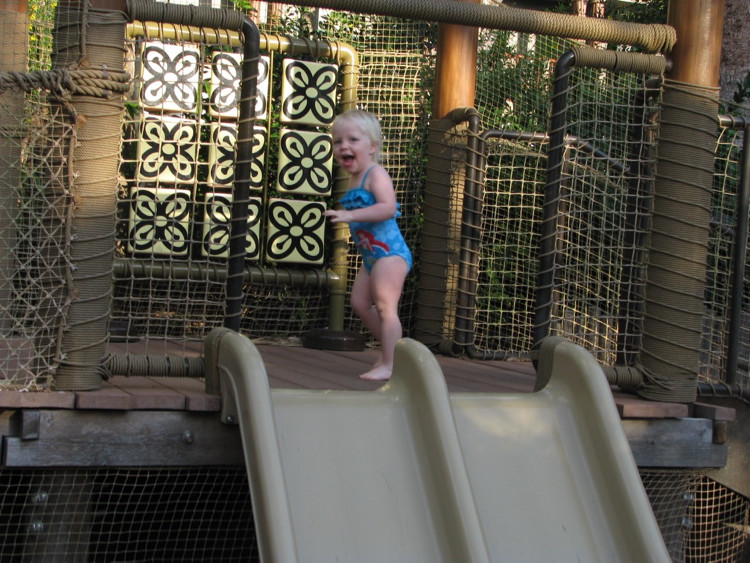 A toddler playing in one of Animal Kingdom Lodge's kids pool areas at Walt Disney World