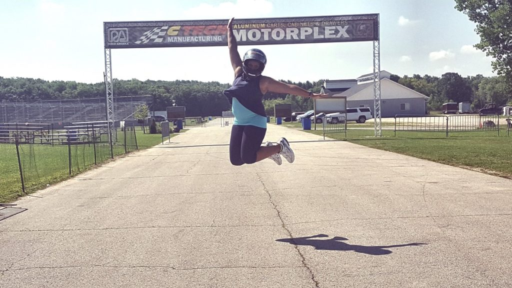 Woman jumps for joy at Road America in Elkhart Lake WI
