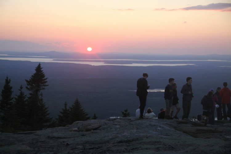 After a family hike, take in the spectacular sunset atop Cadillac Mountain in Acadia National Park in Maine.