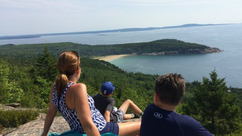 Family resting at the top of Gorham Mountain in Acadia National ParkNational Park near Bar Harbor, Maine.