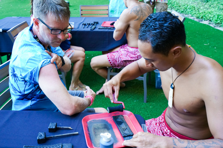Getting a tattoo at Aulani KA WA'A Luau.