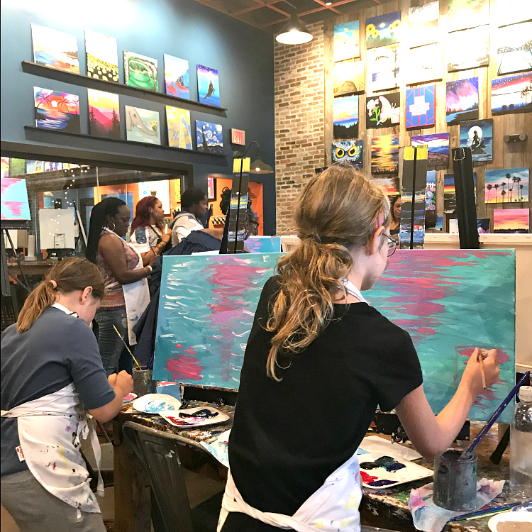 Hard at work at Muse Paintbar at National Harbor. Thinking about visiting National Harbor with kids? Trust a local's guide: here's what to see and do when taking the family to National Harbor, Maryland.