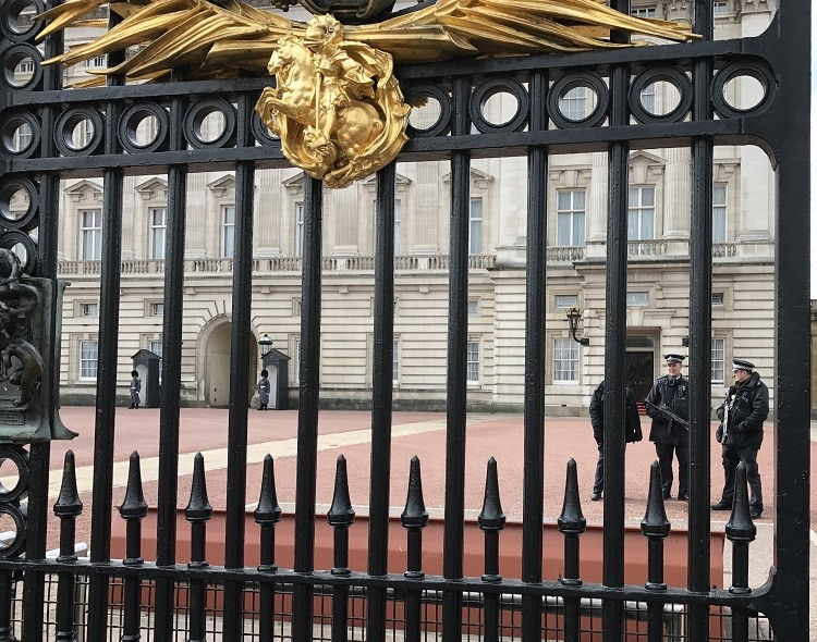 5 Essential Safety Tips for International Travel - beefed up security outside Buckingham Palace the day after the attack.