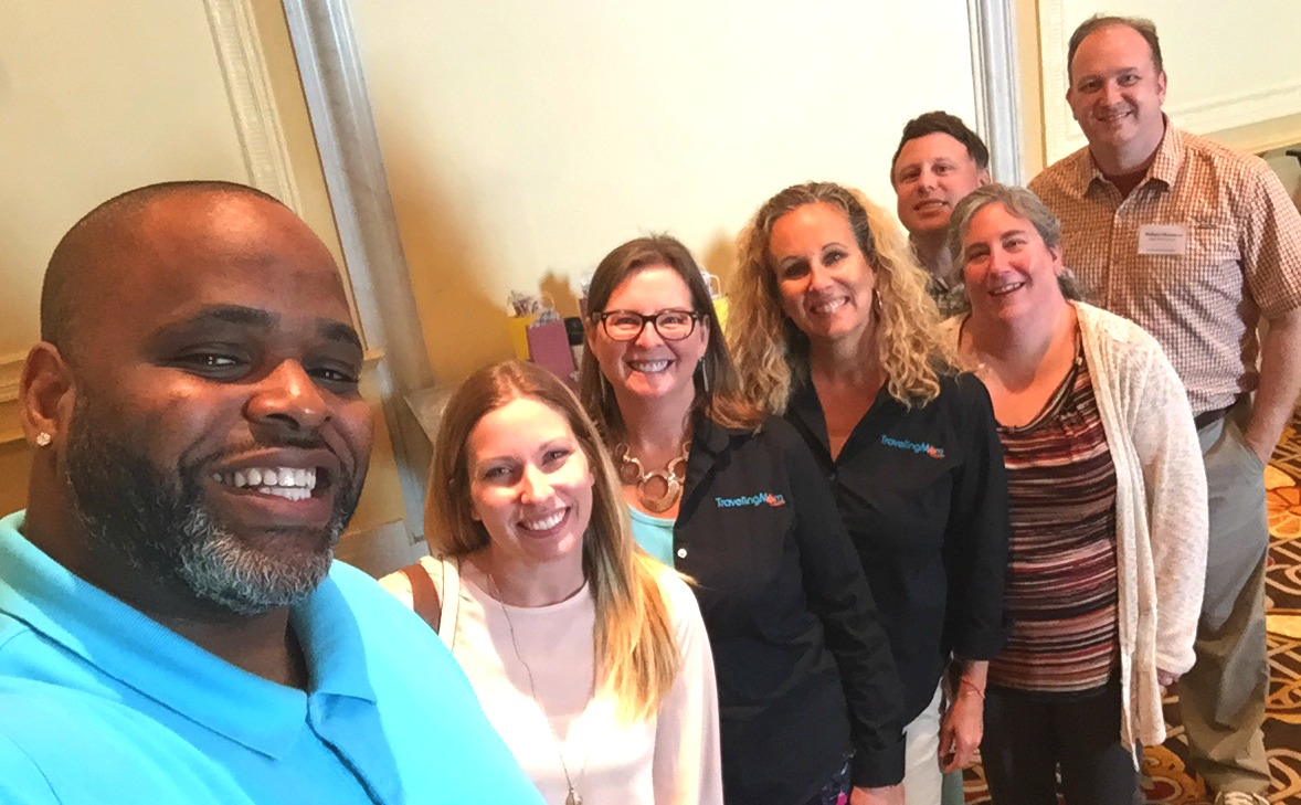 Daymon Patterson, AKA YouTube star Daym Drops, takes a selfies with TravelingMoms Mary Moore, Cindy Richards, Kim Orlando, and Deb Steenhagen, and TravelingDads TJ Burns and Richard Christensen at #TLEDetroit