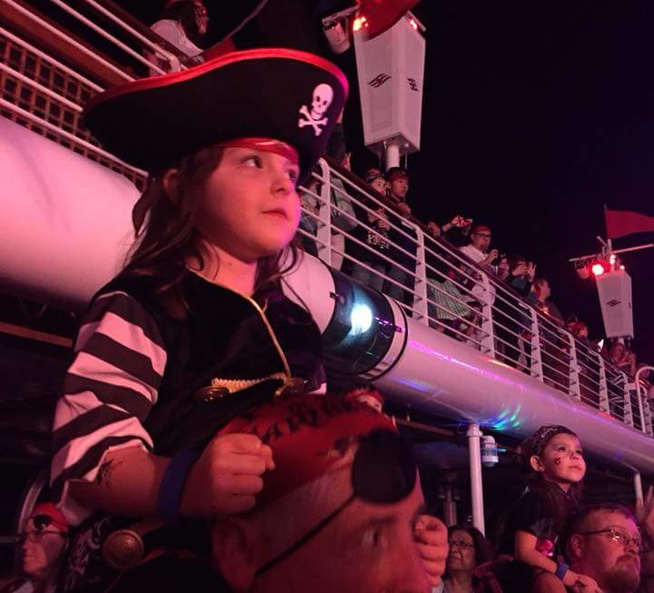 Disney Cruise Tips include bringing a pirate costume or at least a hat for the Pirate Night Celebration like this cute cruiser