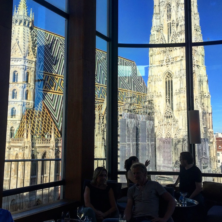 Lookingfor romantic things to do in vienna? This view of St. Stephen's Cathedral seen from the bar across the street
