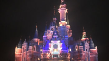 Shanghai Disneyland's Enchanted Storybook Castle lit up before the nighttime show, Ignite the Dream