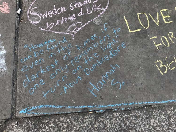 5 Essential Safety Tips for International Travel - Words of hope written on the sidewalk in chalk at the vigil.