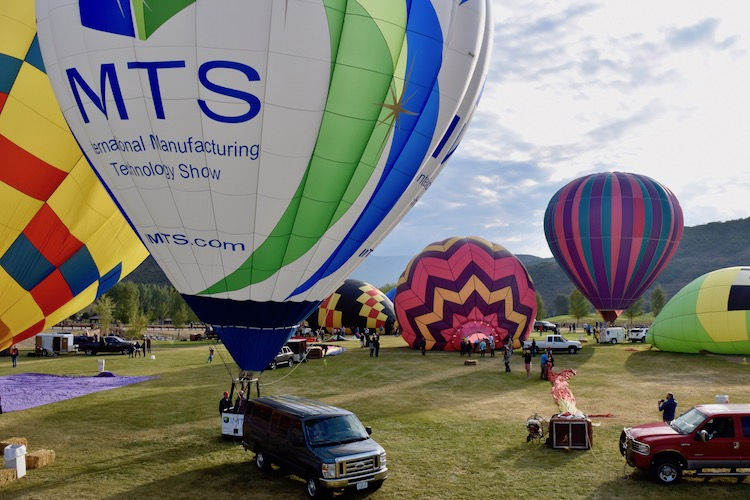 Travel bucket list experience -- watching hot air balloons inflate during Snowmass Balloon Festival in Colorado..