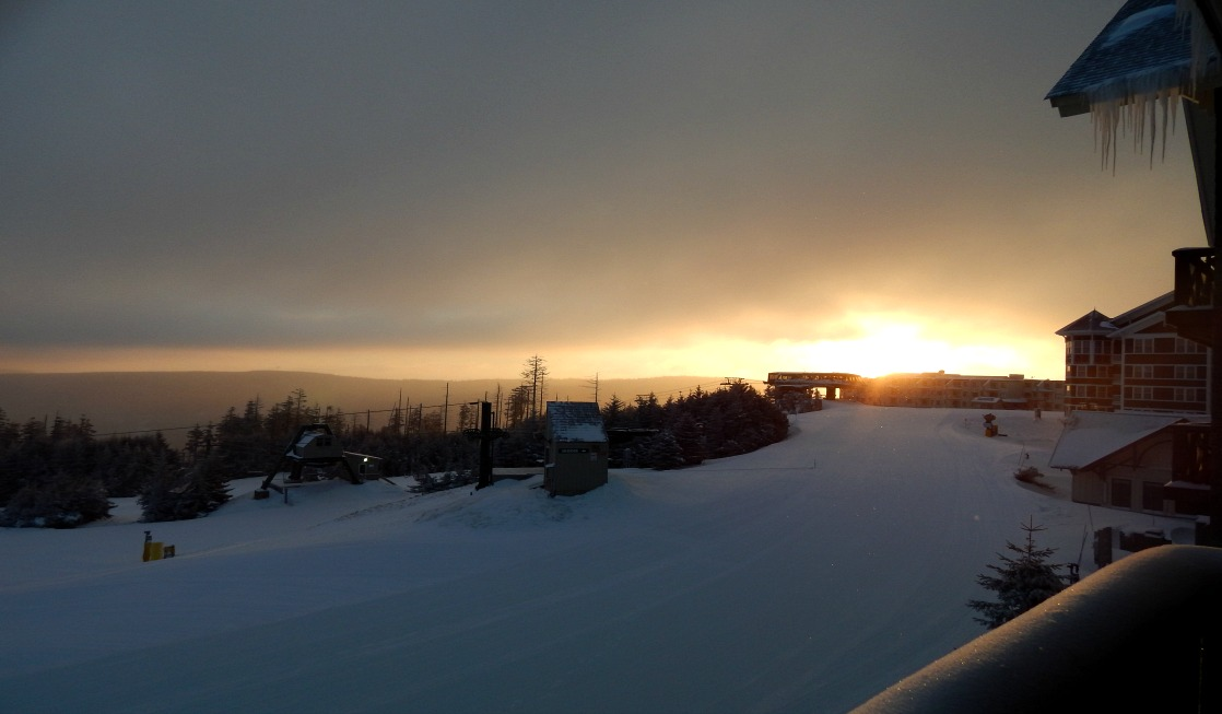 Ask for a resort room with views of the slopes and pretty sunrises when you visit Snowshoe Mountain with family.