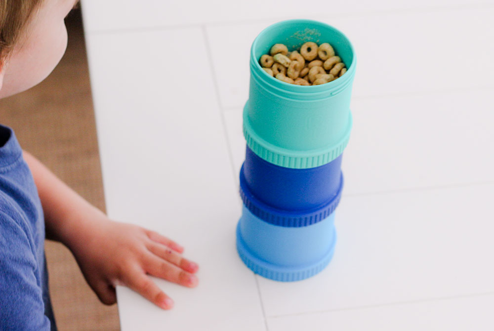 Make sure to pick the right snack cup for traveling. We love the ease and durability of these stacking cups. Photo Credit: Hannah Rinaldi, Fabulously Frugal Traveling Mom