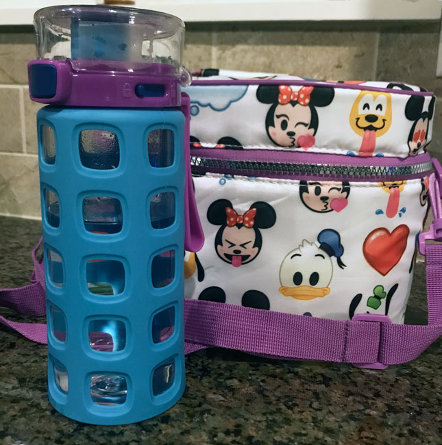Blue and purple water bottle with locking lid (one of our favorite travel accessory for kids!) and a thermal lunchbox featuring Disney emojis