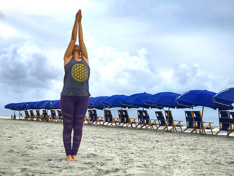 A perfect way to kick off a wellness retreat is with yoga on the beach.