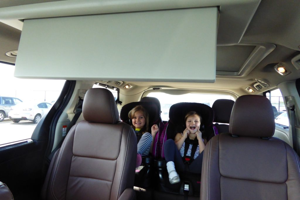 Ready for 2000 miles? These kids are. Try to avoid electronics until you've got a few hours of driving down to minimize meltdowns.