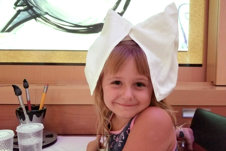 When dining on the Disney Dream, the waiters have all sorts of fun surprises for the kids