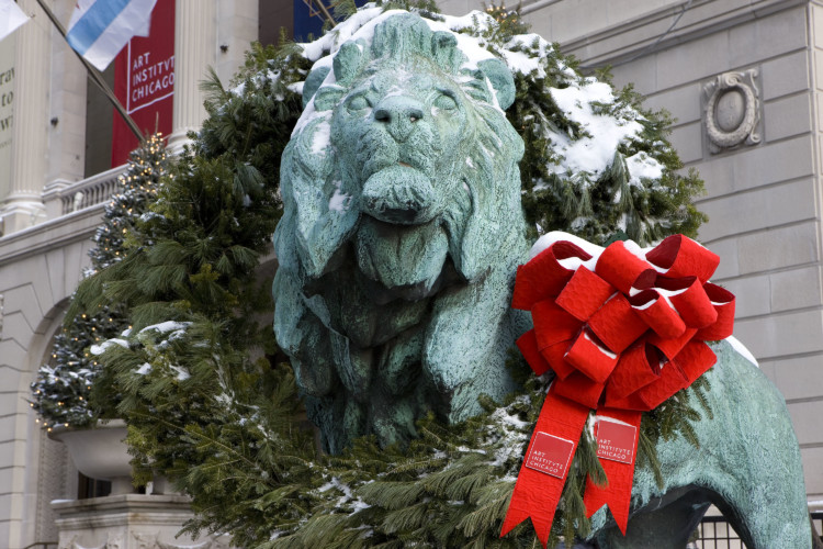 The wreathing of the lions at the Art Institute is one of the most popular holiday events in Chicago.