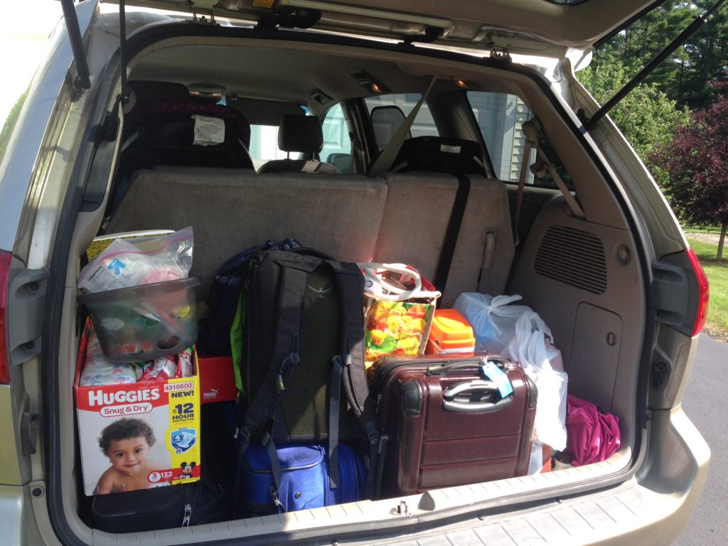 Road trip survival tips -- it all depends on smart packing. Don't make your car a target for break ins by overloading it!