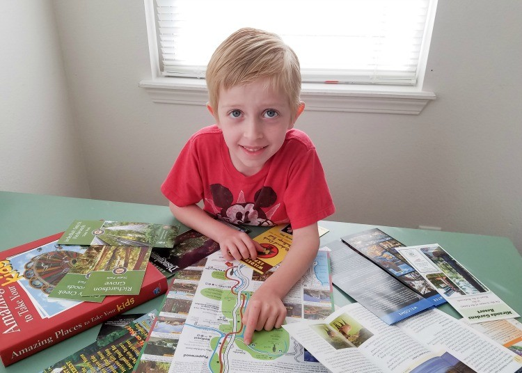 Let your kids help plan vacation by giving them maps and brochures