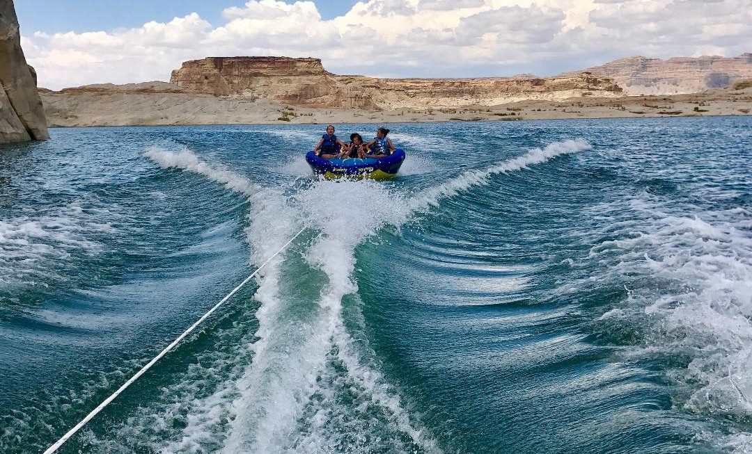Tubing on Lake Powell with kids is another thing to do in Page AZ and tons of fun!