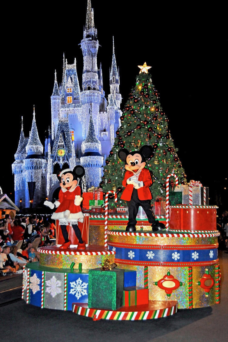 Holidays at Disney: Mickey and Minnie Mouse on a holiday float in front of Cinderella Castle during Mickey's Very Merry Christmas party at Walt Disney World
