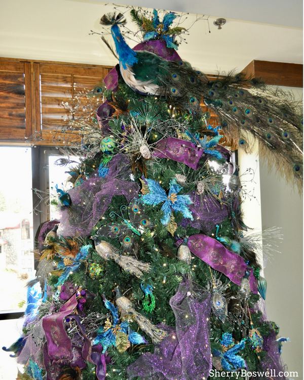 What makes the Omni Grove Park Inn the best Christmas hotel in Asheville? The peacock tree is one of 100 decorated trees.