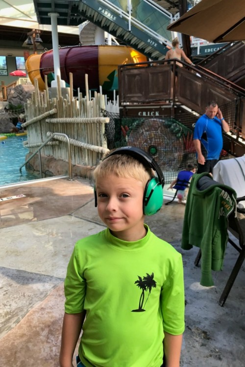 During holiday travel with a special needs child use headphones at crowded holiday events.